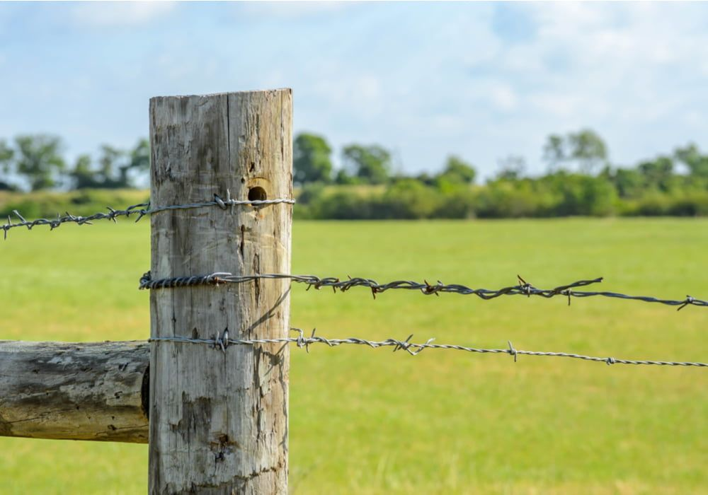 fixing-fence-post