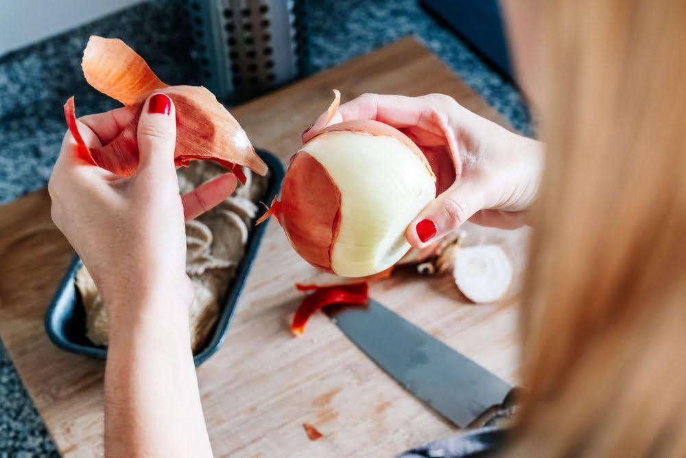 Woman peeling onion