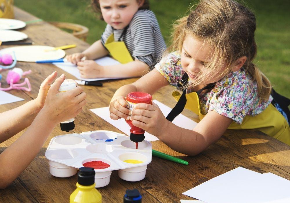 children-painting-outdoor-school-garden