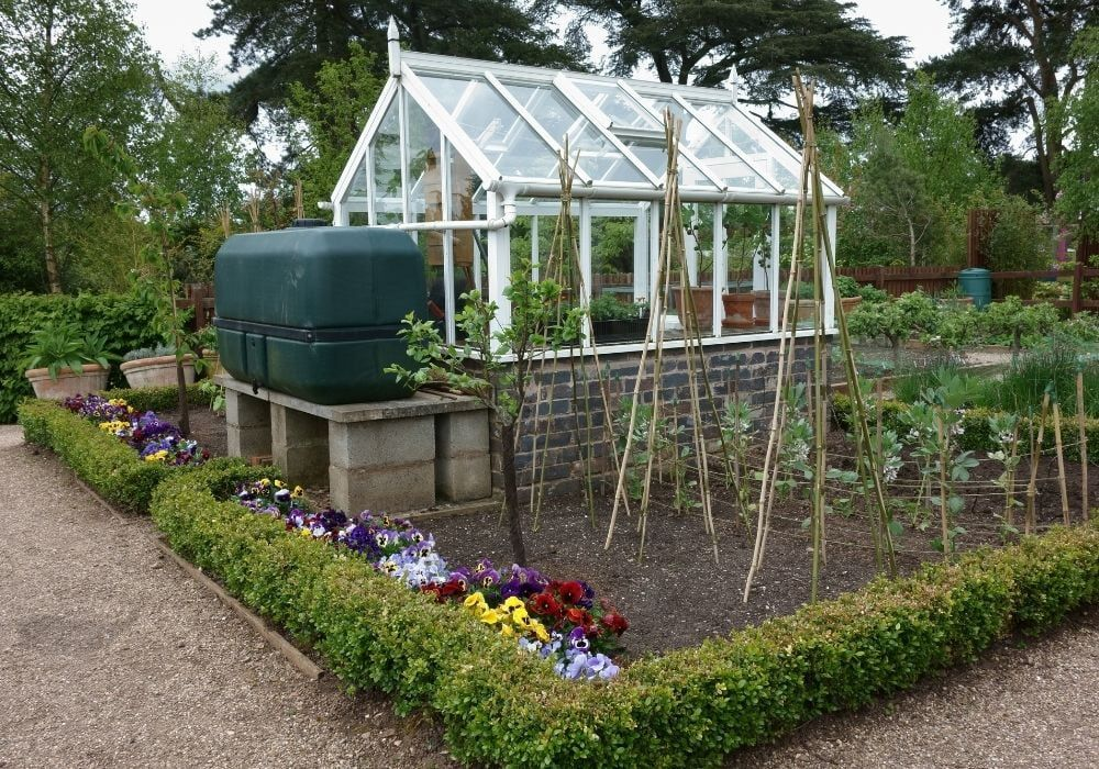small-greenhouse-with-water-tank