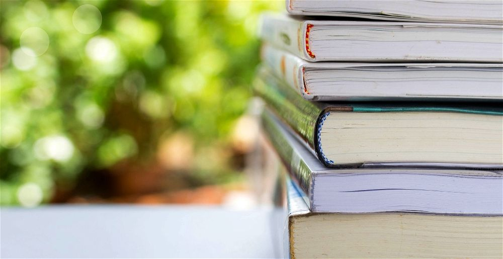 Books on table in garden