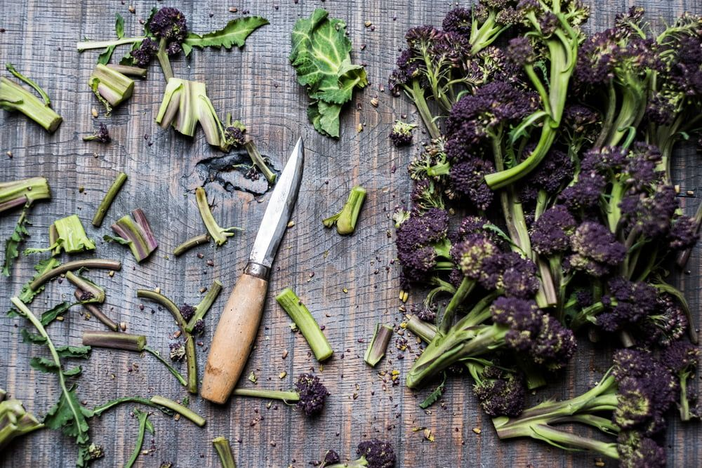 Purple Sprouting Broccoli pieces and knife