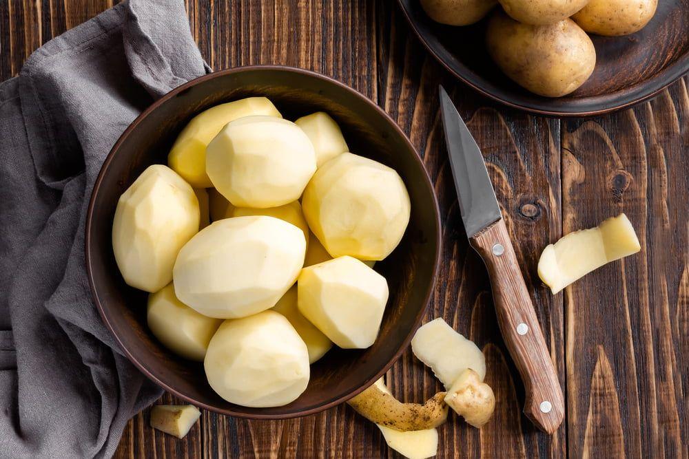 Peeled potatoes in bowl
