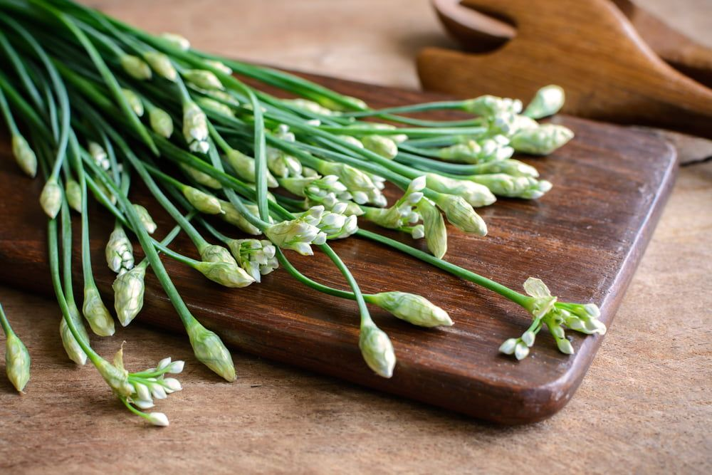 Garlic chives on chopping board