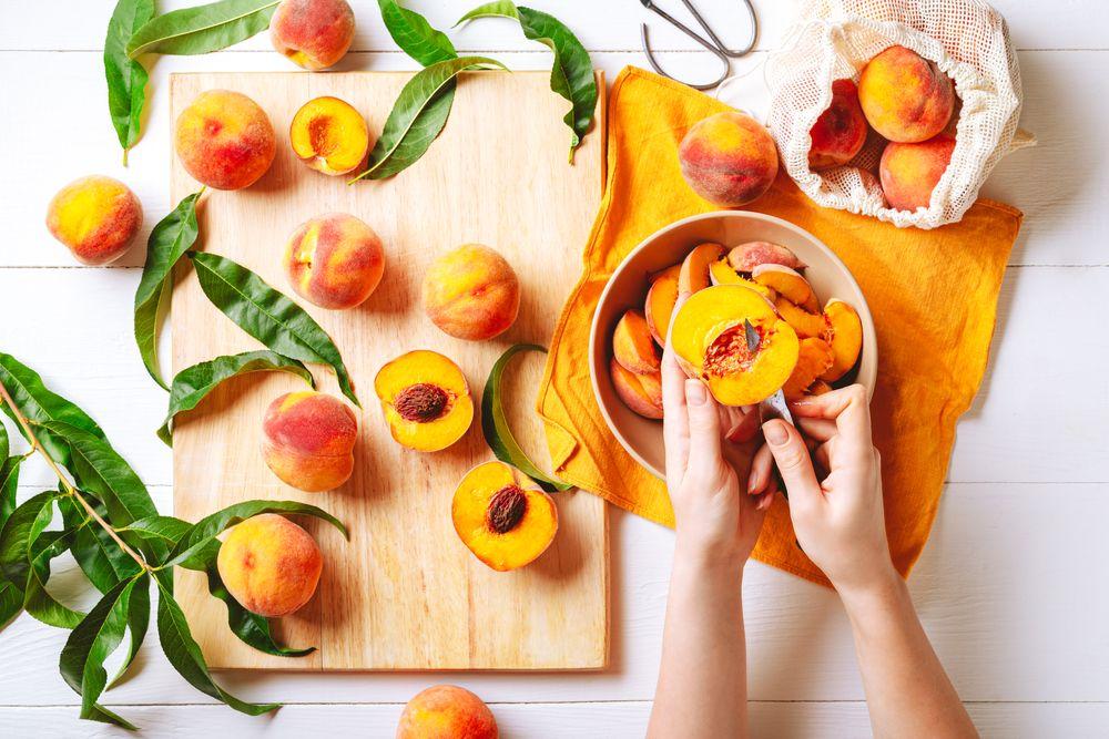 Woman slicing peaches